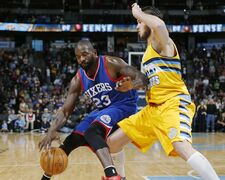 Philadelphia 76ers guard Jason Richardson, left, drives for a shot as Denver Nuggets forward Danilo Gallinari, of Italy, defends in the first quarter of an NBA basketball game Wednesday, March 25, 2015, in Denver. (AP Photo/David Zalubowski)
