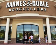 FILE - In this Monday, June 18, 2012, file photo, customers enter the Barnes & Noble Booksellers store in Hoover, Ala. The bookseller, which had planned to combine its Nook Media digital business and its college bookstores into a single company separate from its retail operations, on Thursday, Feb. 26, 2015 said it is keeping Nook after all. (AP Photo/Dave Martin, File)