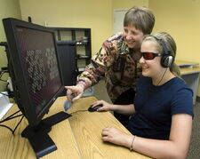 Ingrid Poupart (right) works with Jayme Goldwax on a program to treat dyslexia at her school May 26, 2010 in Montreal.