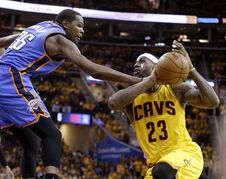 Oklahoma City Thunder's Kevin Durant fouls Cleveland Cavaliers' LeBron James (23) in the fourth quarter of an NBA basketball game Sunday, Jan. 25, 2015, in Cleveland. The Cavaliers won 108-98 to run their winning streak to six games. (AP Photo/Mark Duncan)