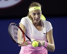 Petra Kvitova of the Czech Republic makes a backhand return to Madison Keys of the U.S. during their third round match at the Australian Open tennis championship in Melbourne, Australia, Saturday, Jan. 24, 2015. (AP Photo/Lee Jin-man)