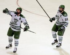 North Dakota players Michael Parks, left and Stephane Pattyn celebrate a goal against Quinnipiac in the first period of a regional semifinal in the NCAA college hockey tournament, Friday, March 27, 2015, in Fargo, N.D. (AP Photo/Bruce Crummy)