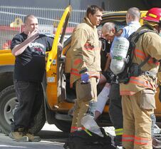 First responders attend to the injured worker.