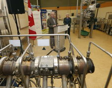 Federal Agriculture Minister Gerry Ritz with CIGI CEO Joanne Booth at an announcement at CIGI's headquarters.