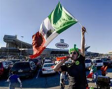 Rafael Gonzalez, of Kansas City, Mo., cheers for Mexico in front of Arrowhead Stadium before the start of a match between the national soccer teams of Mexico and Paraguay on Tuesday, March 31, 2015 in Kansas City, Mo. (AP Photo/The Kansas City Star, Allison Long)