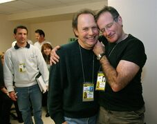 "FILE - This Feb. 28, 2004 file photo shows Oscar host Billy Crystal, center, and presenter Robin Williams, right, joking around after a writers' meeting for the 76th annual Academy Awards in Los Angeles. The producer of the Emmys says that Billy Crystal will pay tribute to Robin Williams during the awards ceremony. Executive producer Don Mischer said that Crystal will honor Williams as part of the traditional ""in memoriam"" segment for industry members who died during the past year. Williams was found dead by suicide in his Northern California home Aug. 11. (AP Photo/Kevork Djansezian, File)"