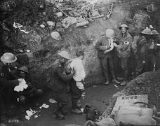 Wounded soldiers are treated in a trench during the Battle of Courcelette. Sept. 15, 1916. Soldiers diaries showcase a dreary, perilous life in First World War trenches.