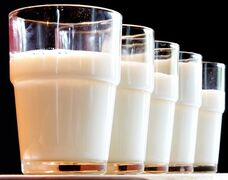 FILE - This Tuesday, July 31, 2007 file photo shows glasses of milk in Frankfurt. In January 2015, embattled U.S. milk producers launched a social media campaign to rebuild public confidence in the health benefits of their product. While the government urges milk consumption, some studies have begun to suggest potential ill effects from drinking too much. (AP Photo/Michael Probst)