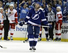 Tampa Bay Lightning center Steven Stamkos heads to the penalty box after a high-sticking penalty was called on him during the third period against the Detroit Red Wings in Game 5 of a first-round NHL Stanley Cup hockey playoff series Saturday, April 25, 2015, in Tampa, Fla. Detroit won 4-0. (AP Photo/Chris O'Meara)