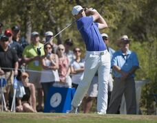 Jordan Spieth watches his drive off the first tee during the third round of the Valero Texas Open golf tournament, Saturday, March 28, 2015, in San Antonio. (AP Photo/Darren Abate)