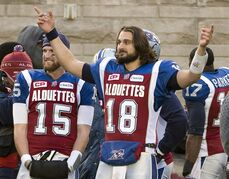 Montreal Alouettes quarterback Jonathan Crompton (18) reacts as the Alouettes beat the B.C. Lions 50-17 in the Canadian Football League Eastern semifinal, Sunday, Nov. 16, 2014 in Montreal. Crompton took over as the starting quarterback midway through the 2014 season and helped the Montreal Alouettes rebound from a dreadful start to finish with a 9-9 record. Now the long-haired pivot is looking forward to being with his teamates from the first day of camp to see how far the Alouettes can go. THE CANADIAN PRESS/Ryan Remiorz