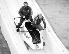 Kaillie Humphries, seen here with D.J. McLelland, is a member of Canada's four-person bobsleigh team.