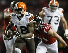 Cleveland Browns wide receiver Josh Gordon (12) moves against Atlanta Falcons outside linebacker Kroy Biermann (71) during the first half of an NFL football game, Sunday, Nov. 23, 2014, in Atlanta. (AP Photo/Brynn Anderson )
