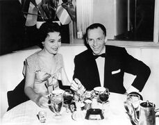 FILE - In this 1954 file photo, Frank Sinatra sits with recording artist Jill Corey at the Harwyn Club in New York. A couple of New York exhibits are paying homage to the centennial of Frank Sinatra's birth by displaying rare photographs and mementos, many of them from the family archive. (AP Photo, File)