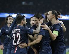 PSG's Edinson Cavani, center, celebrates his opening goal with Zlatan Ibrahimovic, right, Ezequiel Lavezzi, left, and other teammates during the Champions League Group F soccer match between Paris Saint Germain and Ajax at Parc des Princes stadium in Paris, France, Tuesday, Nov. 25, 2014. (AP Photo/Francois Mori)