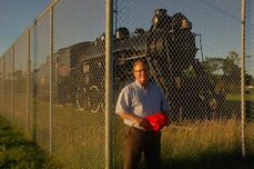 Club of Winnipeg-Transcona president Tom Hallas is shown by the Canadian National 2747 locomotive in Rotary Heritage Park.