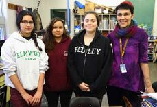 From left to right: Elmwood students Celeste Rivera, Stephanie Chacon-Vega, and Brandy-Rose Street are pictured with art teacher Briony Haig. The students all contributed a title to a new mural, named Everybody has the Right, currently on display at the Canadian Museum for Human Rights.