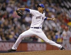 Milwaukee Brewer pitcher Wei-Chung Wang pitches to the St. Louis Cardinals during the ninth inning of MLB National League baseball game Monday, April 14, 2014, in Milwaukee. (AP Photo/Jeffrey Phelps)