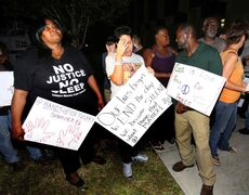 Demonstrators gathered outside the courthouse in Sanford, Fla., react to Ferguson grand jury decision on Monday.