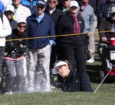 Michelle Wie of Honolulu, HI chips out of a bunker on the 10th hole during the first round of the LPGA's Coates Golf Championship at Golden Ocala Golf and Equestrian Club in Ocala, Fla., on Wednesday, Jan. 28, 2015. (AP Photo/The Star-Banner Photo, Bruce Ackerman)
