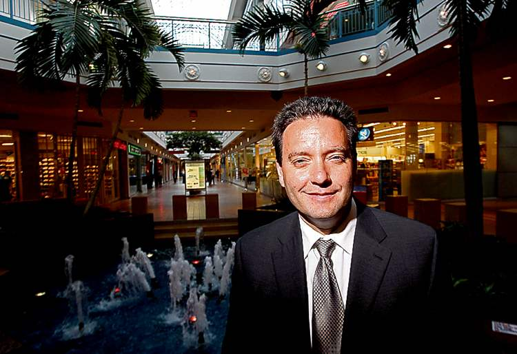 Portage Place is launching conversion in the hope of cutting its vacancy rate, now near 15 per cent, and Stefano Grande of the Downtown BIZ, shown beside the mall's central fountain, says the move makes sense.