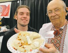 Lawrence Porhownik (right) and James Aitkenhead display some of the perogies made in Garson.