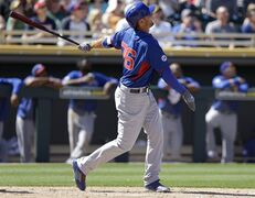 Chicago Cubs' Kris Bryant swings for a home run against the Oakland Athletics in the third inning of a spring training exhibition baseball game Tuesday, March 24, 2015, in Mesa, Ariz. (AP Photo/Ben Margot)