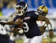 Toronto Argonauts quarterback Steven Jyles runs for a touchdown during first half CFL action against the Winnipeg Blue Bombers in Toronto on Saturday September 24, 2011. THE CANADIAN PRESS/FRANK GUNN