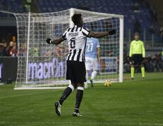 Juventus' Paul Pogba celebrates after scoring his team third goal during the Serie A soccer match between Lazio and Juventus at Rome's Olympic Stadium, Saturday, Nov. 22, 2014. (AP Photo/Gregorio Borgia)