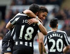 Newcastle United's Ayoze Perez, background center, celebrates his goal with a teammate, during the English Premier League soccer match between Newcastle United and Swansea City at St James' Park, Newcastle, England, Saturday, April 25, 2015. (AP Photo/Scott Heppell)