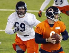 FILE - In this June 17, 2014, file photo, Chicago Bears' defensive end Jared Allen (69) rushes quarterback Jay Cutler during NFLfootball minicamp in Lake Forest, Ill. It was far from a quiet offseason for the Bears, and now they really hope to make some noise. Allen, 32, is the centerpiece of the makeover, the prized signing in free agency. (AP Photo/Charles Rex Arbogast, File)