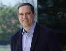 In this Friday, May 1, 2015 photo provided by Cisco Systems Inc., newly named CEO Chuck Robbins poses for a photo in San Jose, Calif. Current CEO John Chambers plans to step down after more than 20 years as CEO, the company announced Monday, May 4, 2015. Robbins will take over the post on July 26. (AP Photo/Cisco Systems Inc., Paul Sakuma)