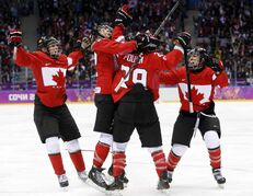 Team Canada celebrates after scoring the winning the women's gold medal ice hockey game 3-1 at the 2014 Winter Olympics. Women's hockey has reached a new zenith in popularity and competitiveness.