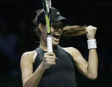 Serbia's Ana Ivanovic celebrates after winning a point against Romania's Simona Halep during their singles match at the WTA tennis finals in Singapore, Friday, Oct. 24, 2014. (AP Photo/Mark Baker)