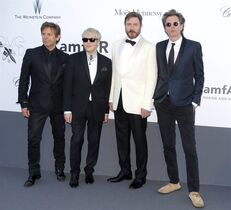 FILE - This May 23, 2013 file photo shows members of Duran Duran, from left, Roger Taylor, Nick Rhodes, Simon Le Bon and John Taylor arrive at amfAR Cinema Against AIDS benefit during the 66th international film festival, in Cap d'Antibes, southern France. The group known for hits like