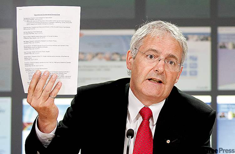 Liberal MP Marc Garneau holds a list of organizations opposed to the census change.
