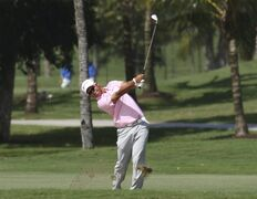 Hideki Matsuyama, of Japan, hits from the 11th fairway during the first round the Cadillac Championship golf tournament in Doral, Fla., Thursday, March 5, 2015. (AP Photo/J Pat Carter)
