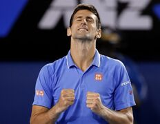 Novak Djokovic of Serbia celebrates after defeating Andy Murray of Britain in the men's singles final at the Australian Open tennis championship in Melbourne, Australia, Sunday, Feb. 1, 2015. (AP Photo/Vincent Thian)