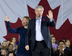 Prime Minister Stephen Harper and his wife Laureen Harper wave as Harper announces tax cuts and increased benefits for families at the Joseph and Wolf Lebovic Jewish Community Campus in Vaughan, Ont., on Thursday, October 30, 2014. THE CANADIAN PRESS/Nathan Denette