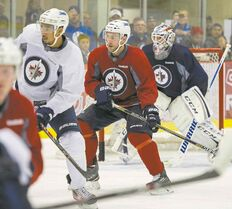 Winnipeg Jets Grant Clitsome (centre) during an on-ice workout Saturday morning.