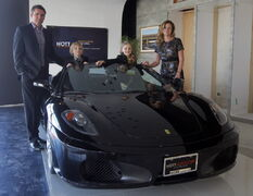 Trevor, Jack, Ella and Amber Nott (son Carter was away) with a Ferrari F430 Spider in the showroom of the new Nott Autocorp location at McGillivray and Waverley.