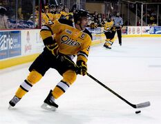 Erie Otters' Connor McDavid controls the puck during an OHL game against the Sarnia Sting in Erie, Pa., Saturday, Oct.4, 2014. McDavid is among 32 players chosen to represent the Ontario Hockey League in the upcoming Super Series against Russia's national junior team.THE CANADIAN PRESS/HO-Erie Otters-Matt Mead
