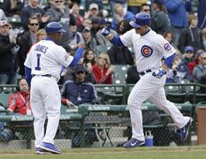Chicago Cubs' Anthony Rizzo, right, celebrates with third base coach Gary Jones after hitting a solo home run during the eighth inning of a baseball game against the Arizona Diamondbacks in Chicago, Thursday, April 24, 2014. (AP Photo/Nam Y. Huh)
