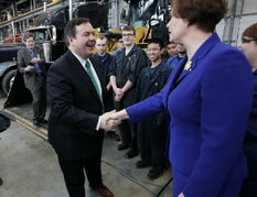 Jason Kenney, Minister of Employment and Social Development, meets with Theresa Oswald, Manitoba Minister of Jobs and transportation trade students at a Canada Job Grant press conference in Winnipeg, Wednesday.