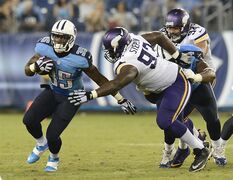 Tennessee Titans running back Antonio Andrews (35) gets past Minnesota Vikings defensive tackle Shamar Stephen (93) in the third quarter of a preseason NFL football game Thursday, Aug. 28, 2014, in Nashville, Tenn. (AP Photo/Mark Zaleski)