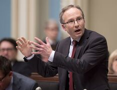 Quebec Treasury board president Martin Coiteux during question period, Tuesday, November 25, 2014 at the legislature in Quebec City. THE CANADIAN PRESS/Jacques Boissinot