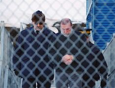Eric Dejaeger is escorted by police outside an Iqaluit, Nunavut courtroom Jan. 20, 2011. The former Arctic priest defrocked for sexual misbehaviour will face trial on two sex-related charges in Edmonton. THE CANADIAN PRESS/Chris Windeyer