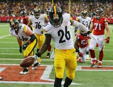 Steelers running back Le'Veon Bell (26) celebrates in the endzone after scoring a touchdown in the final minute of the first half of the NFL football game on Sunday, Dec. 14, 2014, in Atlanta. (AP Photo/Atlanta Journal-Constitution, Curtis Compton) MARIETTA DAILY OUT; GWINNETT DAILY POST OUT; LOCAL TELEVISION OUT; WXIA-TV OUT; WGCL-TV OUT