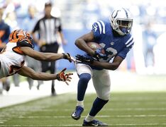 Indianapolis Colts wide receiver T.Y. Hilton runs out of the tackle of Cincinnati Bengals cornerback Leon Hall during the first half of an NFL football game Sunday, Oct. 19, 2014, in Indianapolis. (AP Photo/AJ Mast)