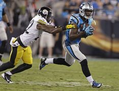 Carolina Panthers' Jason Avant, right, catches a pass as Pittsburgh Steelers' William Gay, left, defends during the first half of an NFL football game in Charlotte, N.C., Sunday, Sept. 21, 2014. (AP Photo/Bob Leverone)